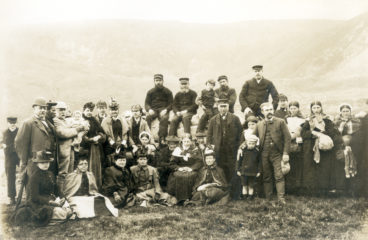 A group of St Kildans with visitors and a ship's crew pictured in the Village on Hirta, St Kilda.